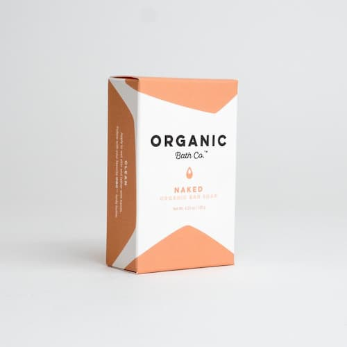 White and nude box that contains Naked Organic Bar Soap