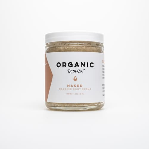 Crytal jar that contains the Organic Body Scrub Naked