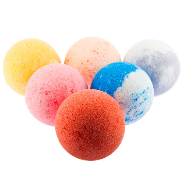 Image of various scents of bath bombs laying in a triangle