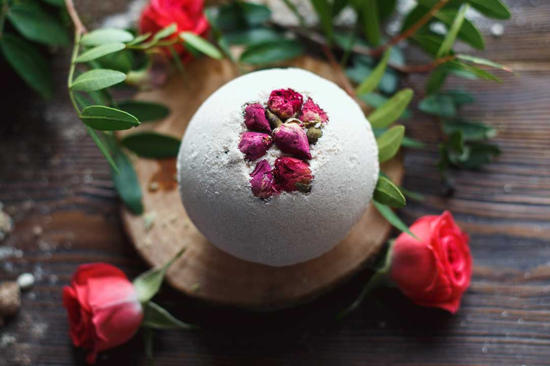 Image of finished bath-bomb with tiny dried roses